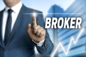 """man in business suit pointing a finger with a light emitting from the tip. the word """"broker"""" is written next to the hand in a bold font. there is a graph at the bottom"""