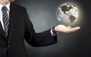 a customs broker with a globe floating in his hand