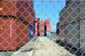 close up of wire mesh fence enclosing a container yard