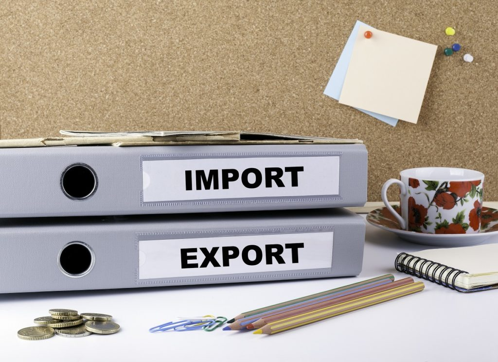 gray binders labeled import and export holding records of customs transactions