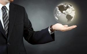 Custom broker holds hologram of the world globe in the palm of his left hand.